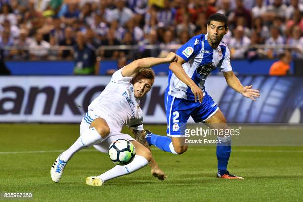 Juanfran of RC Deportivo La Coruna competes for the ball with Toni Kroos of Real Madrid during the La Liga match between Deportivo La Coruna and Real...