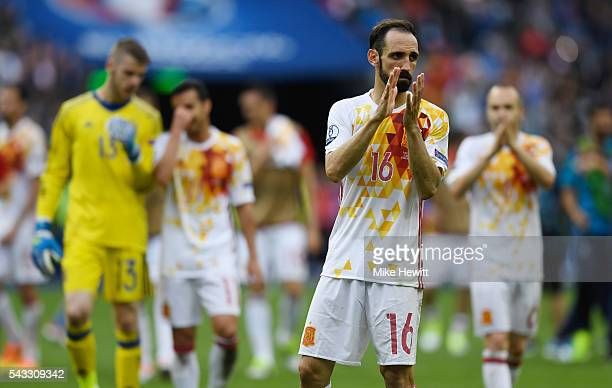 Juanfran of Spain applauds the supporters after his team's 02 defeat in the UEFA EURO 2016 round of 16 match between Italy and Spain at Stade de...