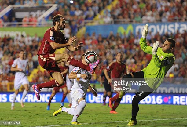 Juanfran of Spain clashes with Tome Pacovski of FYR of Macedonia during the UEFA EURO 2016 Group C Qualifier between Spain and FYR of Macedonia at...