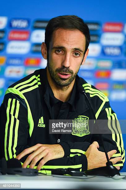 Juanfran of Spain faces the media during a Spain press conference ahead of the 2014 FIFA World Cup Group B match between Australia and Spain at Arena...