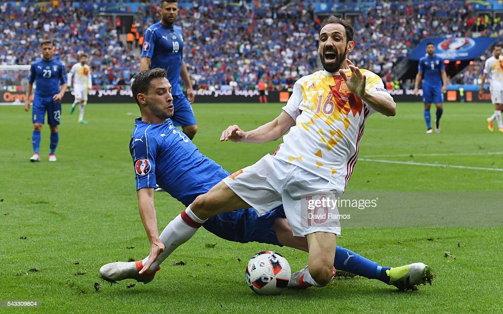 Juanfran of Spain is tackled by <a gi-track='captionPersonalityLinkClicked' href=/galleries/search?phrase=Mattia+De+Sciglio&family=editorial&specificpeople=8709670 ng-click='$event.stopPropagation()'>Mattia De Sciglio</a> of Italy during the UEFA EURO 2016 round of 16 match between Italy and Spain at Stade de France on June 27, 2016 in Paris, France.