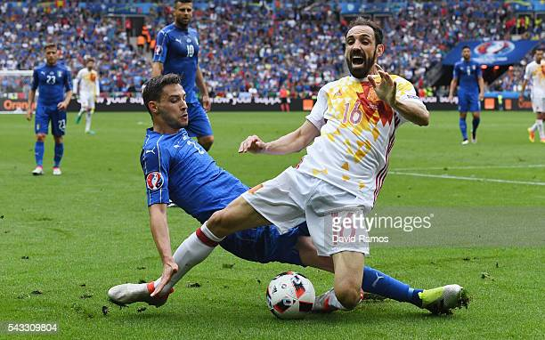 Juanfran of Spain is tackled by Mattia De Sciglio of Italy during the UEFA EURO 2016 round of 16 match between Italy and Spain at Stade de France on...
