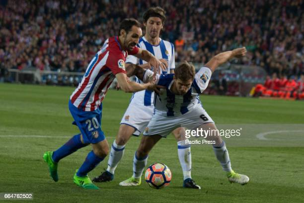 Juanfran try to evade Iñigo Martinez during the match between Atletico de Madrid and Real Sociedad AtMadrid won over Real Sociedad with 10