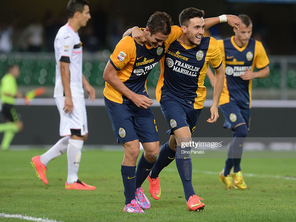 Juanito Gomez Tab (C) of Hellas Verona celebrates after scoring his teams second goal during the Serie A match between Hellas Verona FC and US Citta di Palermo on September15, 2014 in Verona, Italy.