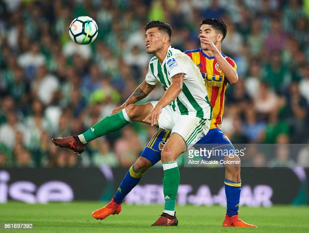 Juanjo Narvaez of Real Betis Balompie competes for the ball with Carlos Soler of Valencia CF during the La Liga match between Real Betis and Valencia...