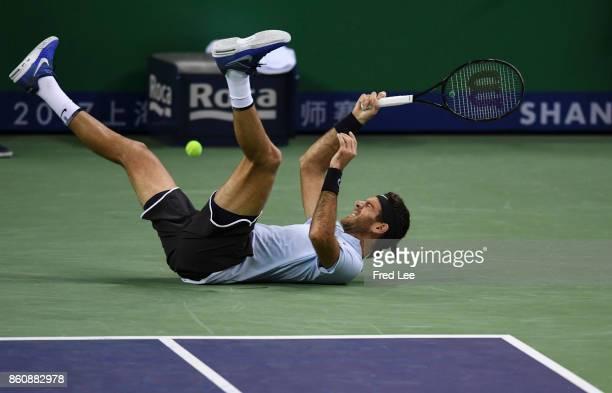 JuanMartin Del Potro of Argentina slips fall during agains the Men's singles quarter final mach Viktor Troicki of Serbia on day six of 2017 ATP...