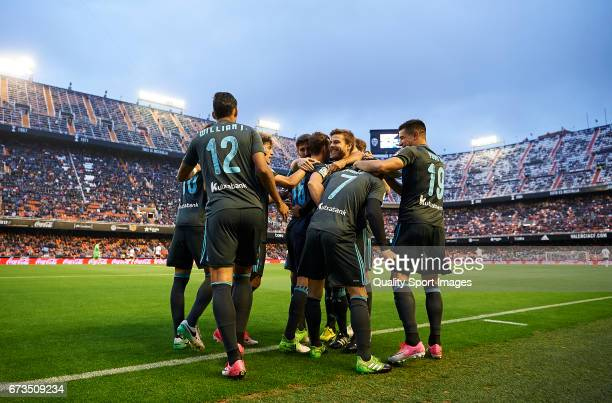 Juanmi Jimenez of Real Sociedad celebrates with his teammates after scoring the First goal during the La Liga match between Valencia CF and Real...