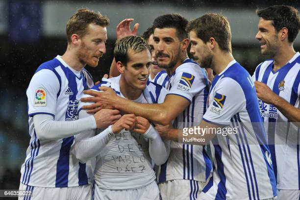 Juanmi of Real Sociedad celebrates with teammates after scoring during the Spanish league football match between Real Sociedad and Eibar at the...