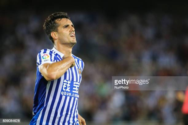 Juanmi of Real Sociedad celebrates with teammates after scoring during the Spanish league football match between Real Sociedad and VilaReal at the...