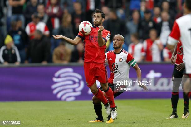 Juanmi of Real Sociedad de Futbol Karim El Ahmadi of Feyenoord during the preseason friendly match between Feyenoord Rotterdam and Real Sociedad at...
