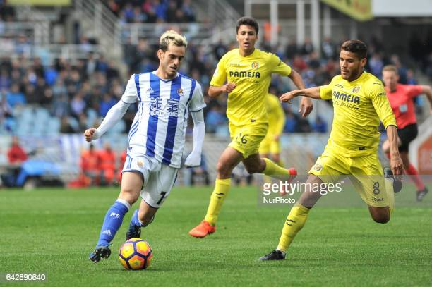 Juanmi of Real Sociedad duels for the ball with Rodrigo and J Dos Santos during the Spanish league football match between Real Sociedad and...