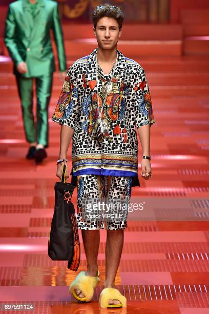 Juanpa Zurita walks the runway at the Dolce Gabbana show during Milan Men's Fashion Week Spring/Summer 2018 on June 17 2017 in Milan Italy