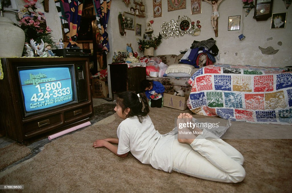 A girl watching television.