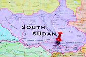 Photo of pinned Juba on a map of Africa. May be used as illustration for traveling theme.