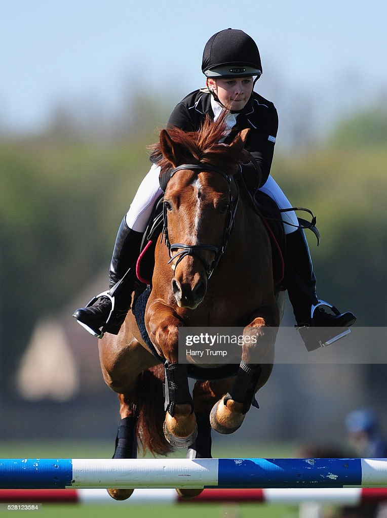 Juba ridden by Claire Hunt jumps a fence during the Mitsubishi Motors Cup Show Jumping during Day One of the Badminton Horse Trials on May 4, 2016 in Badminton, Untied Kindom.