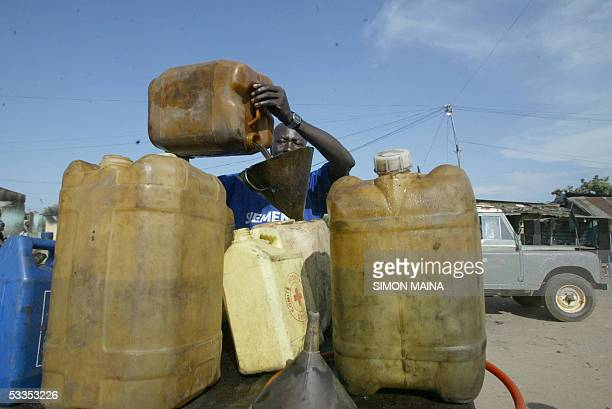 A southern Sudanese petrol peddler sells fuel in the town of Juba 11 August 2005 Oil is so scarce in the southern region despite the fact that the...