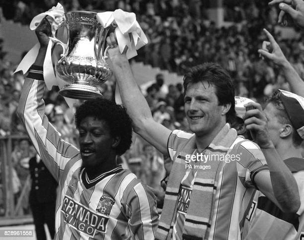 Jubilant Coventry City goal scorers Dave Bennett and Keith Houchen hold the coveted FA Cup aloft after beating Tottenham Hotspur in the final at...