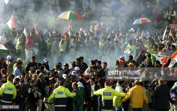 Jubilant Indian fans are scattered by fireworks at Old Trafford Manchester following their sides victory over Pakistan in the Cricket World Cuptoday