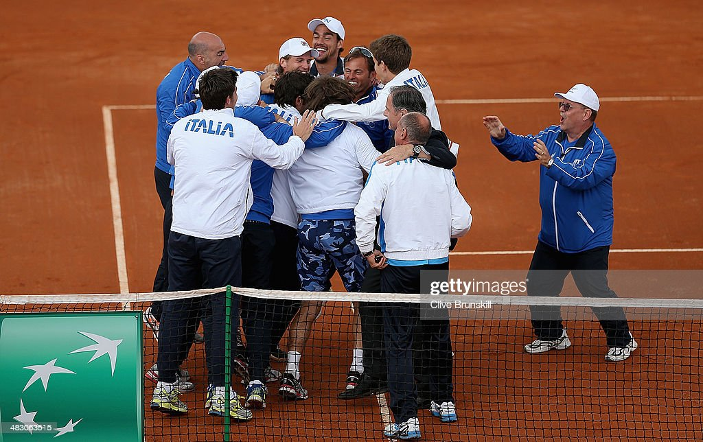 A jubilant Italian team celebrate advancing to the semi-finals after James Ward of Great Britain lost the fifth and decisive rubber to Andreas Seppi of Italy during day three of the Davis Cup World Group Quarter Final match between Italy and Great Britain at Tennis Club Napoli on April 6, 2014 in Naples, Italy.