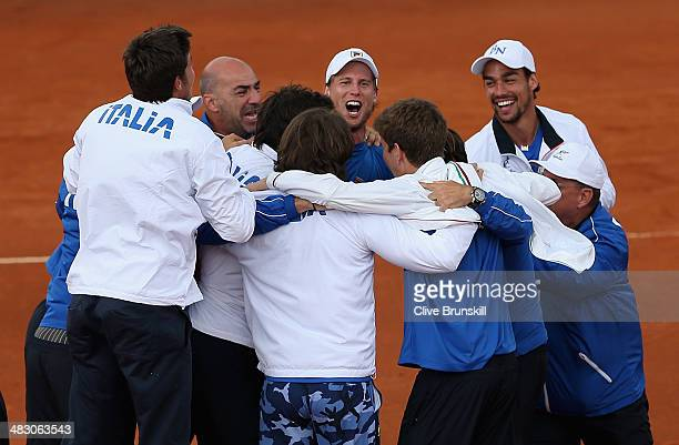 A jubilant Italian team celebrate advancing to the semifinals after James Ward of Great Britain lost the fifth and decisive rubber to Andreas Seppi...