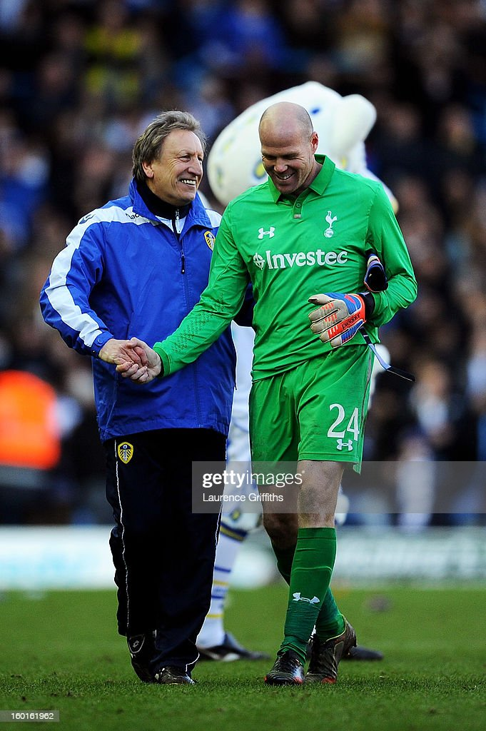 A jubilant <a gi-track='captionPersonalityLinkClicked' href=/galleries/search?phrase=Neil+Warnock&family=editorial&specificpeople=644786 ng-click='$event.stopPropagation()'>Neil Warnock</a> the Leeds manager shakes hands with defeated <a gi-track='captionPersonalityLinkClicked' href=/galleries/search?phrase=Brad+Friedel&family=editorial&specificpeople=210857 ng-click='$event.stopPropagation()'>Brad Friedel</a> of Spurs following his team's 2-1 victory the FA Cup with Budweiser Fourth Round match between Leeds United and Tottenham Hotspur at Elland Road on January 27, 2013 in Leeds, England.