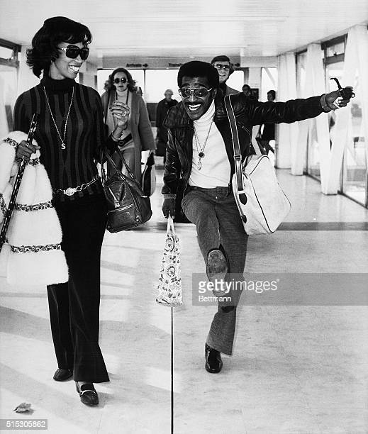 A jubilant Sammy Davis Jr dances near his wife Altovise GoreDavis at Heathrow Airport as they prepare to return to Los Angeles after a threeweek...