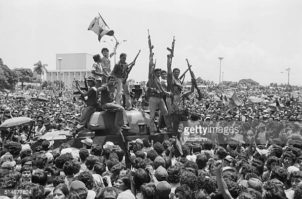 Jubilant Sandinista rebels ride a small tank in the main square of Managua as junta arrives June 20 1979 to take control of the government