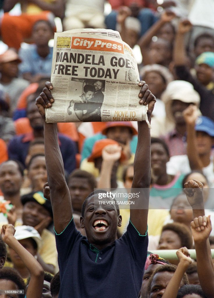 A jubilant Sowetan holds up 11 February 1990 in Soweto a newspaper announcing the release of antiapartheid leader and African National Congress...