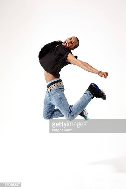 Jubilant young man in mid air