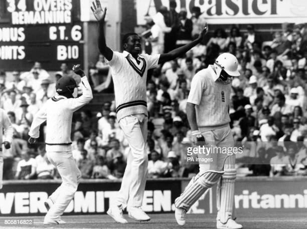 Jubilation West Indies bowler Curtly Ambrose and Gus Logie as England's Rob Bailey begins the long walk back to the Pavilion
