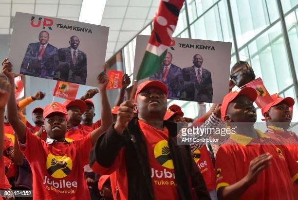 Jubilee Party supporters of Kenya's President Uhuru Kenyatta cheer during the unveiling of the Jubilee Party's manifesto on June 26 2017 in Nairobi /...