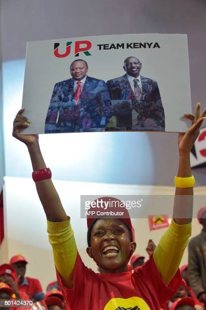 Jubilee Party supporters of Kenya's President Uhuru Kenyatta cheer during the unveiling of the Jubilee Party's manifesto on June 26 2017 in Nairobi /...