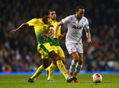 Jucilei of Anzhi Makhachkala tackles Andros Townsend of Tottenham Hotspur during the UEFA Europa League Group K match between Tottenham Hotspur FC...