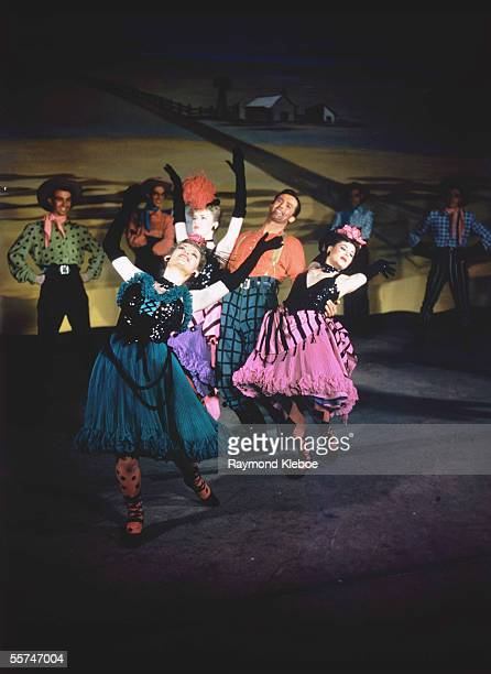 Jud the farm hand dances with the saloon girls in the dream ballet in a production of 'Oklahoma' at the Theatre Royal Drury Lane 9th August 1947...