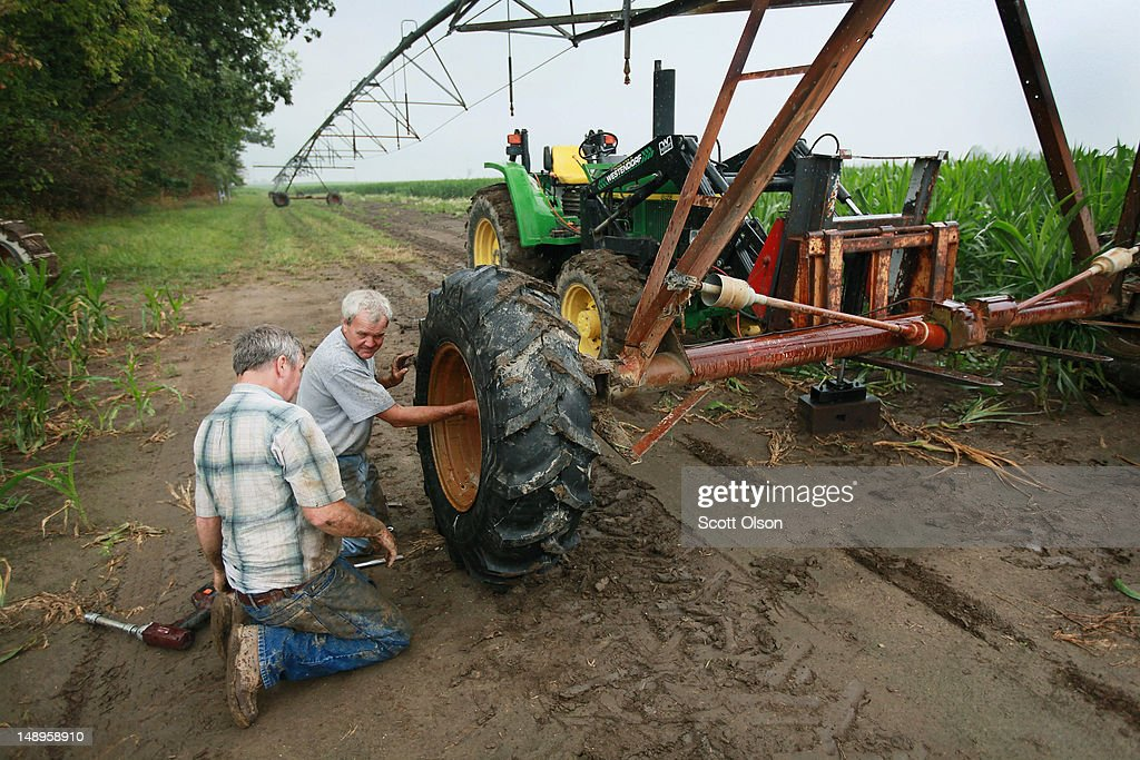 Jud Vaught (L) and his brother Bill Kirklin change a tire on an irrigation system in their cornfield on July 20, 2012 near Whiteland, Indiana. Kirklin and Vaught, who are 6th generation Indiana farmers, raise about 1,500 acres of corn and soybeans on a farm founded by their family in 1835. The corn and soybean belt in the middle of the nation is experiencing one of the worst droughts in more than five decades. Indiana was the nation's fourth largest corn producer in 2011.