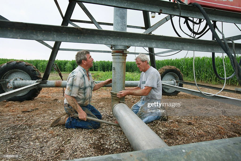 Jud Vaught (L) and his brother Bill Kirklin connect an irrigation system in their cornfield on July 20, 2012 near Whiteland, Indiana. Kirklin and Vaught, who are 6th generation Indiana farmers, raise about 1,500 acres of corn and soybeans on a farm founded by their family in 1835. The corn and soybean belt in the middle of the nation is experiencing one of the worst droughts in more than five decades. Indiana was the nation's fourth largest corn producer in 2011.