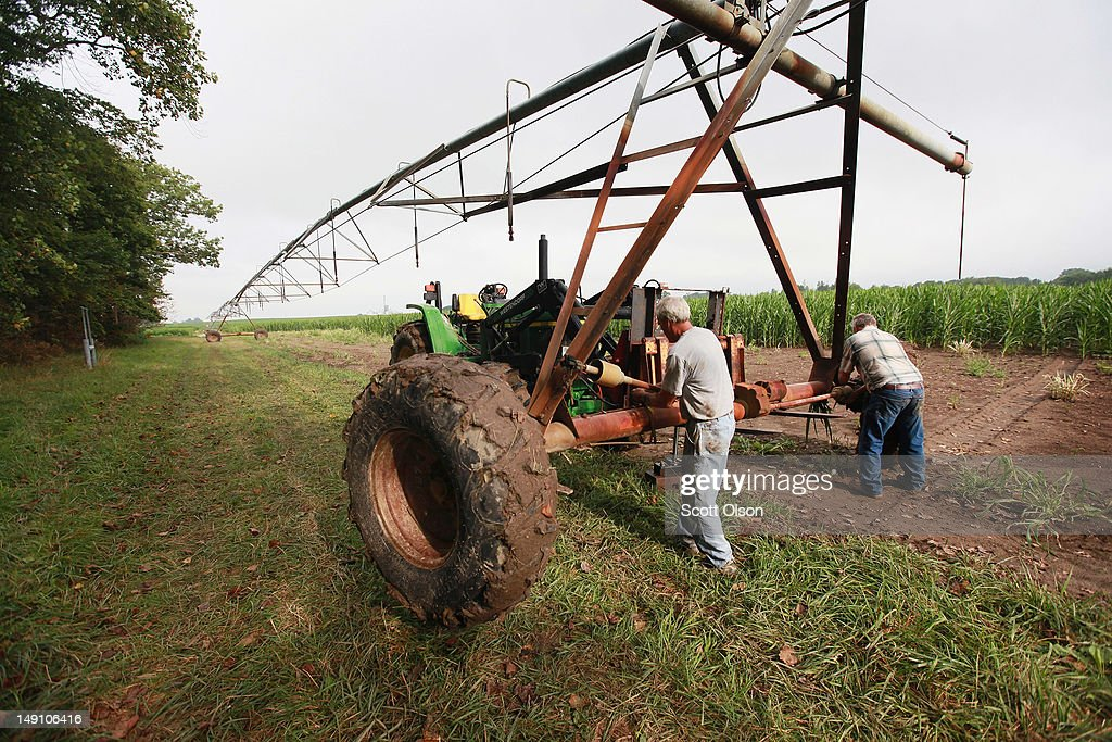 Jud Vaught (R) and his brother Bill Kirklin setup an irrigation system in their cornfield on July 20, 2012 near Whiteland, Indiana. Kirklin and Vaught, who are 6th generation Indiana farmers, raise about 1,500 acres of corn and soybeans on a farm founded by their family in 1835. The corn and soybean belt in the middle of the nation is experiencing one of the worst droughts in more than five decades. Indiana was the nation's fourth largest corn producer in 2011.