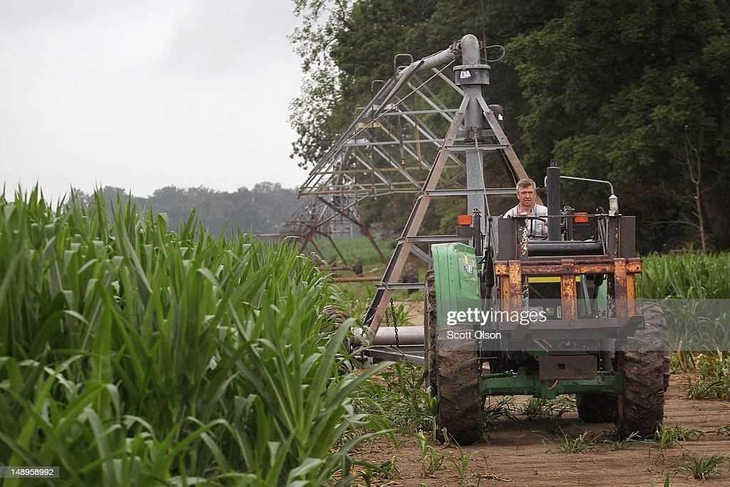 Jud Vaught moves an irrigation system in his cornfield on July 20, 2012 near Whiteland, Indiana. Vaught and his brother Bill Kirklin, who are 6th generation Indiana farmers, raise about 1,500 acres of corn and soybeans on a farm founded by their family in 1835. The corn and soybean belt in the middle of the nation is experiencing one of the worst droughts in more than five decades. Indiana was the nation's fourth largest corn producer in 2011.