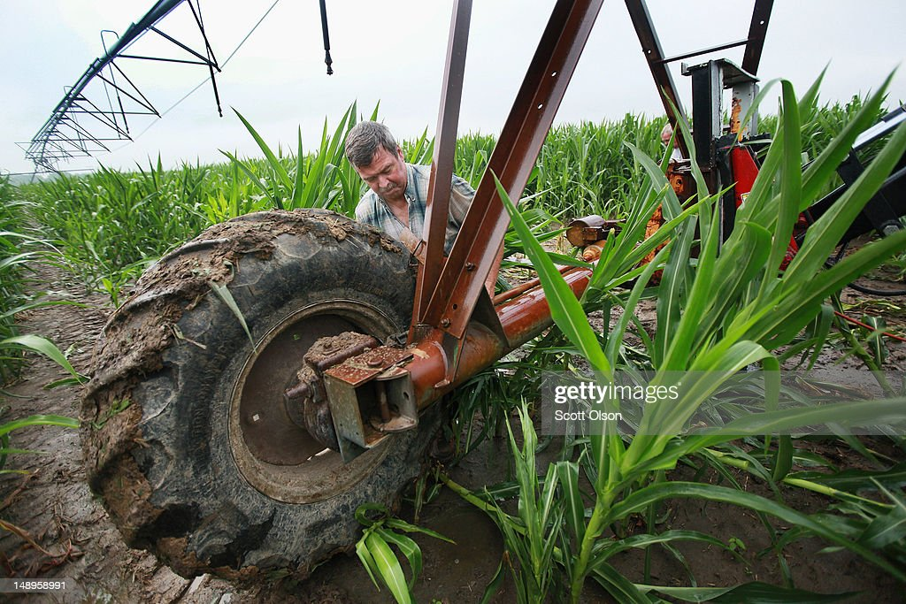 Jud Vaught sets up an irrigation system in his cornfield on July 20, 2012 near Whiteland, Indiana. Vaught and his brother Bill Kirklin, who are 6th generation Indiana farmers, raise about 1,500 acres of corn and soybeans on a farm founded by their family in 1835. The corn and soybean belt in the middle of the nation is experiencing one of the worst droughts in more than five decades. Indiana was the nation's fourth largest corn producer in 2011.