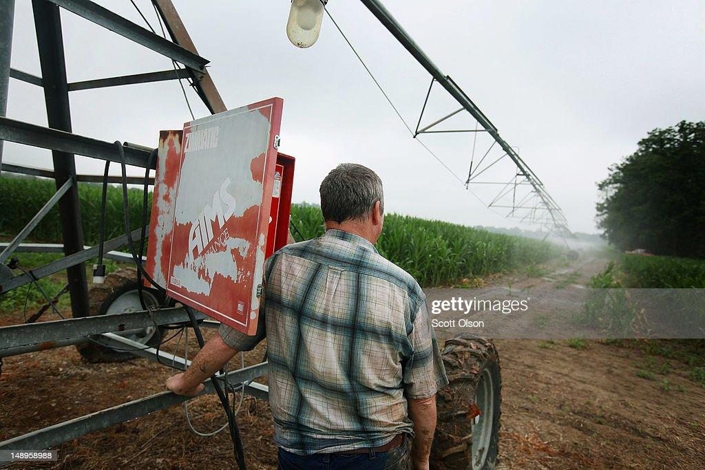 Jud Vaught turns on an irrigation system in his cornfield on July 20, 2012 near Whiteland, Indiana. Vaught and his brother Bill Kirklin, who are 6th generation Indiana farmers, raise about 1,500 acres of corn and soybeans on a farm founded by their family in 1835. The corn and soybean belt in the middle of the nation is experiencing one of the worst droughts in more than five decades. Indiana was the nation's fourth largest corn producer in 2011.