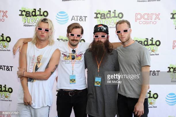 Judah Akers Spencer Cross Brian Macdonald and Nate Zuercher of the band Judah and The Lion pose with Solar Eclipse glasses at the Radio 1045 Summer...