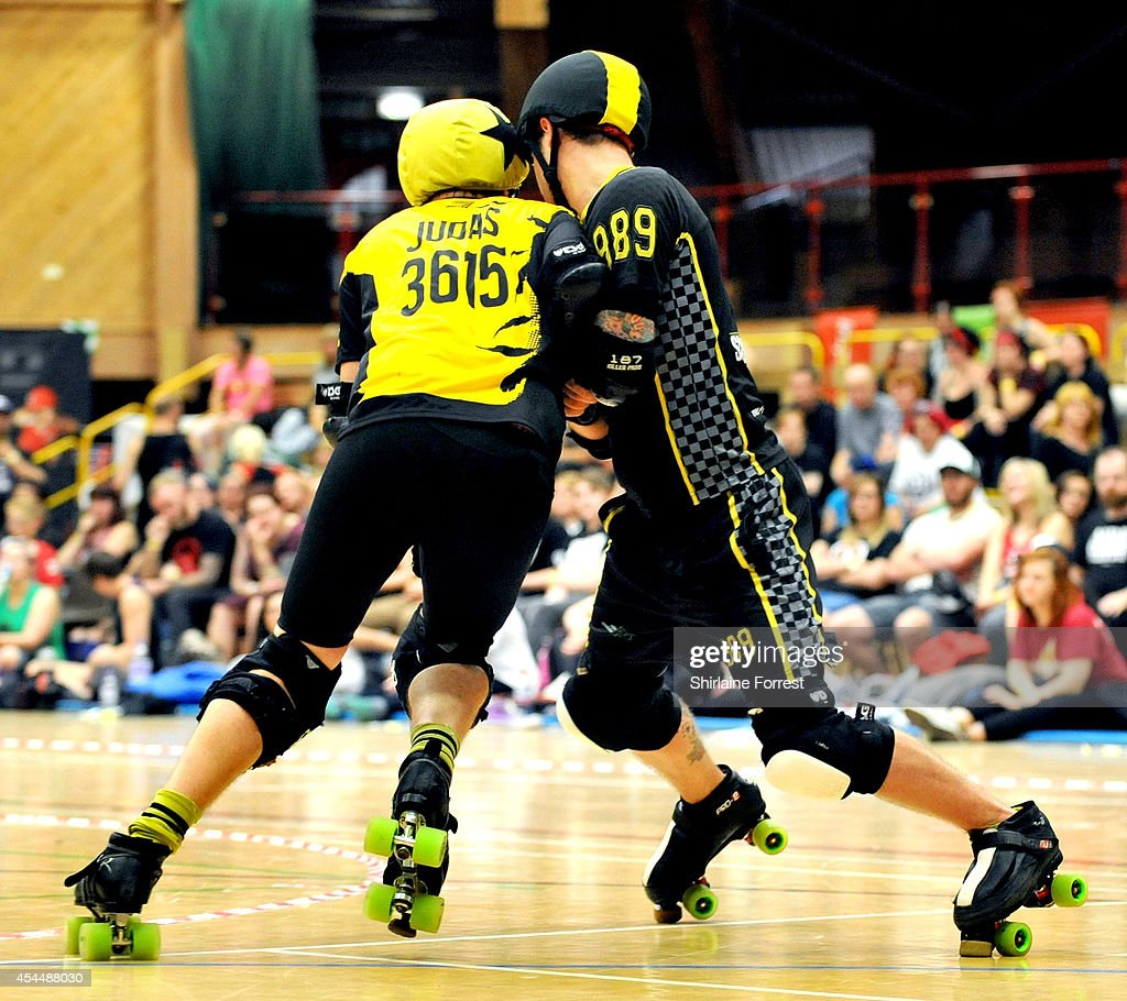 Judas of Panam Squad and Alligately of Crash Test Brummies bout in the Men's European Cup roller derby tournament at Walker Activity Dome on August 31, 2014 in Newcastle upon Tyne, England.