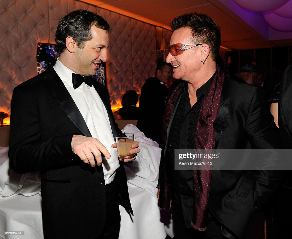 Judd Apatow and Bono attend the 2013 Vanity Fair Oscar Party hosted by Graydon Carter at Sunset Tower on February 24, 2013 in West Hollywood, California.