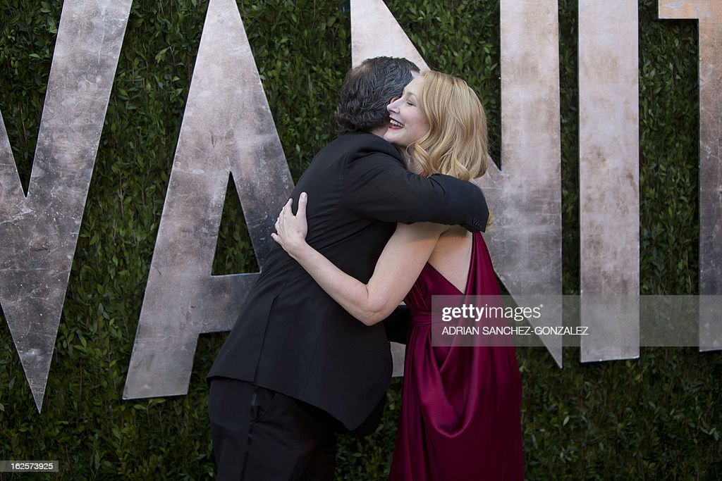 Judd Apatow and Patricia Clarkson arrive for the 2013 Vanity Fair Oscar Party on February 24, 2013 in Hollywood, California.AFP PHOTO/ADRIAN SANCHEZ-GONZALEZ