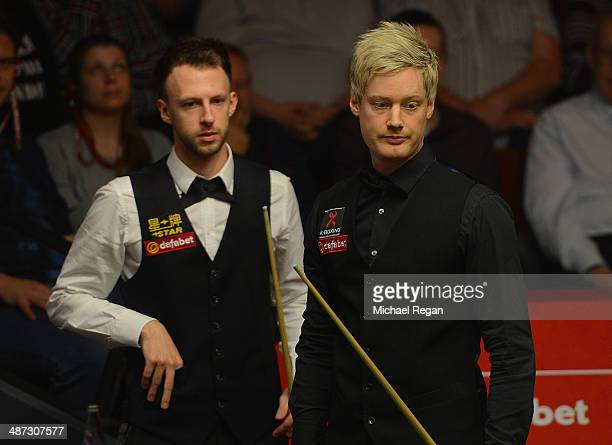 Judd Trump and Neil Robertson look on during their quarter final match at the Crucible Theatre on April 29 2014 in Sheffield England