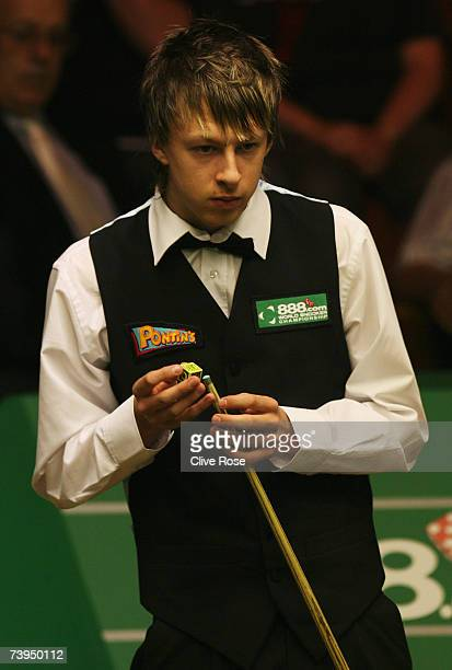 Judd Trump looks on during his first round match against Shaun Murphy in the 888com World Championship at the Crucible Theatre on April 23 2007 in...