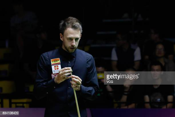 Judd Trump of England chalks the cue during his first round match against Daniel Wells of Wales on day two of Evergrande 2017 World Snooker China...