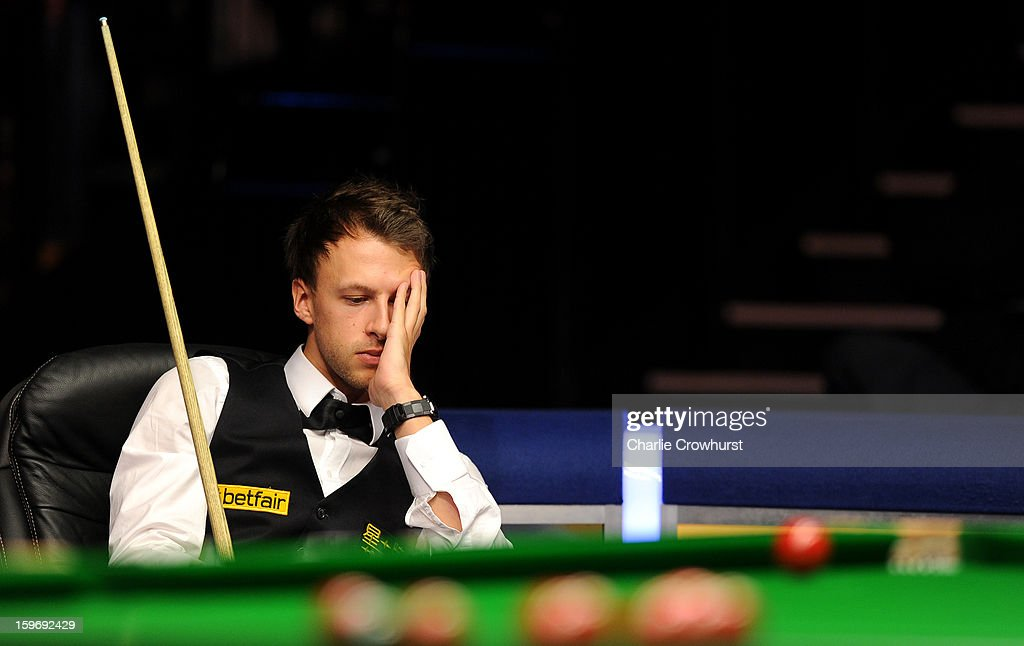Judd Trump of England looks on dejected during his quarter-final match against Graeme Dott of Scotland on day 6 of The Masters at Alexandra Palace on January 18, 2013 in London England.