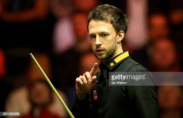 Judd Trump of England looks on during his first round match against Stephen Maguire of Scotland on day Two of the 2015 Dafabet Masters at Alexandra...