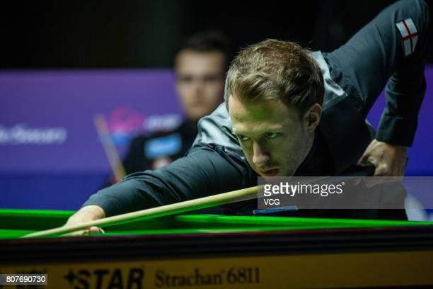 Judd Trump of England plays a shot against Alexander Ursenbacher of Switzerland and Darren Paris of Switzerland on day one of 2017 Snooker World Cup...